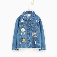 RIPS AND PATCHES DENIM JACKET
