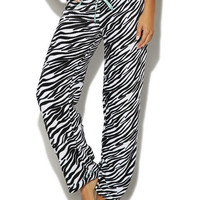"This super comfortable plush pant is a must have! Features a soft zebra pattern knit body, contrast stitching, and a banded elastic waist with a ribbon drawstring. Model is 5'10"" and wears a size small • 100% Polyester • Machine Wash • Imported"
