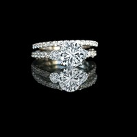 1.5 ct round diamond simulant - diamond veneer® center, three stones ring engagement set.635r205