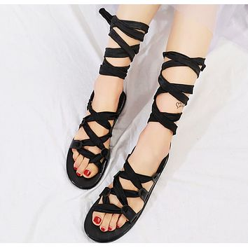 Fashionable ankle band strap toe flat Roman sandals for women Black