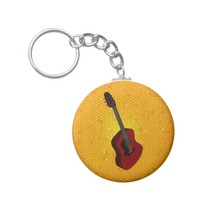 Keychain with acoustic guitar illustration