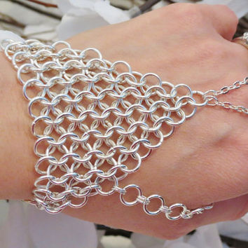 Armor Chainmail Slave Bracelet Ring. Durable 18 gauge Sterling Silver plated Iron Metal jump rings were used. Custom Sized