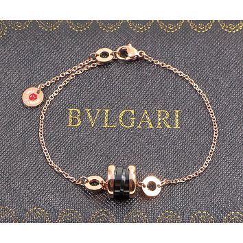 ... limited guantity BVLGARI Charity Little Red Man Black Ceramic Bracelet  Men and Wo dc1d026efa ... b2977ffe26
