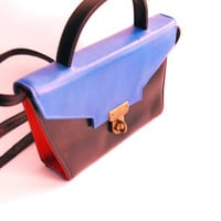 color block shoulder handbag, hardcase clutch in blue, red and black