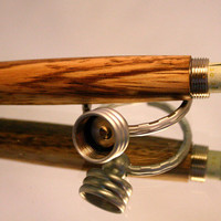 Wood Keychain with secret compartment made of zebra wood with satin chrome setting