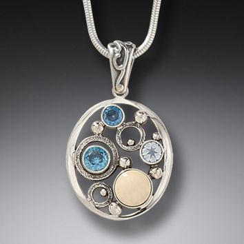 """""""Arctic Dreams"""" Ancient Fossilized Mammoth Ivory Tusk, Blue Topaz and Rainbow Moonstone Silver Pendant"""