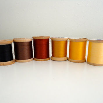 Vintage sewing thread lot of 6 wooden spools in fall colors, hues yellow, gold, brown, rust and black