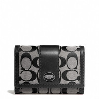 legacy compact clutch in signature fabric
