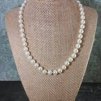 Traditional off white hand tied faux glass pearl necklace. Not ivory, not bright white, just a natural white color. Classic piece.