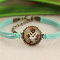 bracelet--lovely cat bracelet,retro bronze charm,glass cover picture,cyan leather bracelet