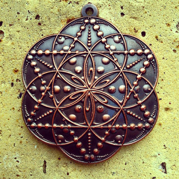 Drop, Seed Of Life Pendant By Enlighten. Artwork By Tyler Epe.  Original Sacred Geometry Jewelry by Enlighten