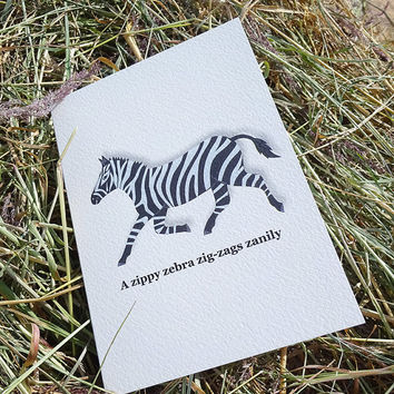 Zebra card, beautifully black and white, hand-illustrated zippy zebra design complete with tongue-twisting alliterative phrase