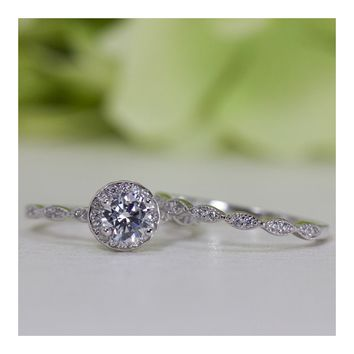 0.50 Ct. Halo Round Cubic Zirconia Engagement Ring Set In Sterling Silver