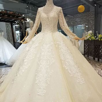 Champagne ball gown wedding dresses high neck long sleeve open keyhole back can add lining floor length dresses