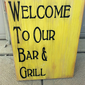 Welcome sign, bar and grill, subway wood