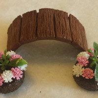Fairy garden accessories. Fairy bridge and two flower beds.