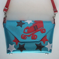 Light blue metalflake handbag w red roller derby skate and red, black, and white stars