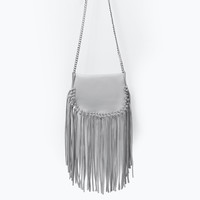 Fringed leather messenger bag with chain