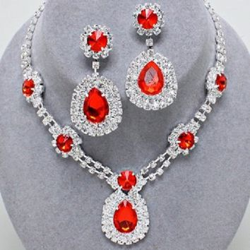 """Silvertone Rhinestone Necklace and Earring Set with Red Detail. Necklace Size : 15"""" + 4"""" L, 1 3/4"""" L. Earring Size : 2 1/4"""" L."""