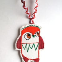 Christmas owl ornament hand embroidered geometric shapes in bright reds and greens on cream muslin and cream felt with holiday ribbon loop