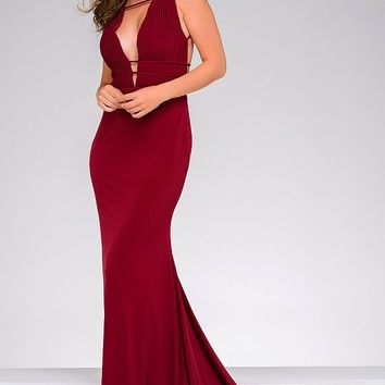 Fitted burgundy sleeveless floor length gown with a rushed bodice.