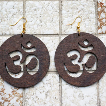 Earrings wood: Spiritual Ohm, symbol for universal Spirituality, Lasercut birch plywood, gold colored hooks, stain coated