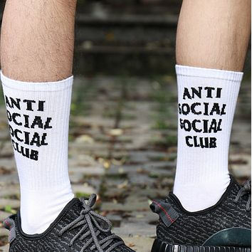 Anti social club Men and women in black and white wild skateboarding in the tube socks White