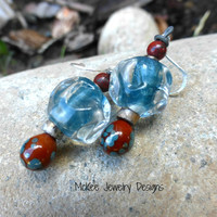 Blue and brown Lampwork glass, stone, ceramic, and silver metal earrings.