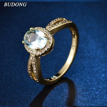 BUDONG Gorgeous Halo Ladies Finger Band  Gold Color Ring for Women Oval Light Blue Crystal Zirconia Engagement Jewelry XUR339