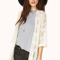 Whimsical Open-Knit Cardigan