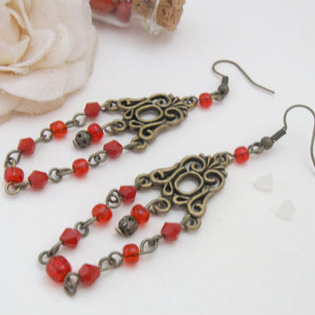 Red Currant - chandelier earrings with art deco bronze ornament and red beads