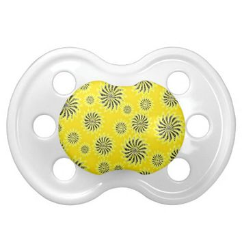 Spinning stars energetic pattern yellow pacifier