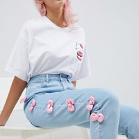 Hello Kitty x ASOS DESIGN jeans with satin bow detail at asos.com