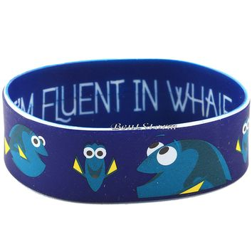 Licensed cool Disney Finding Dory Nemo I am Fluent in Whale Blue Rubber Bracelet Wristband NEW