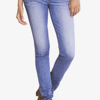Faded Medium Wash Blue Mid Rise Jean Legging from EXPRESS