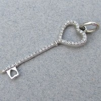 Delicate 10k White Gold Diamond Enhanced Vintage KEY Pendant