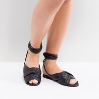 ASOS DESIGN Wide Fit Valley leather knotted tie leg flat sandals at asos.com