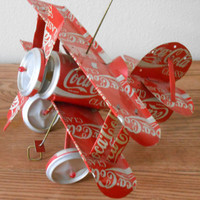 CoCa Cola Airplane. Vintage Red Airplane Made from Cans.