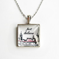 "Pendant charm with glass dome. Inspirational quote ""Just believe"". London"