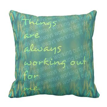 Bright yellow blue and green patterned saying throw pillow