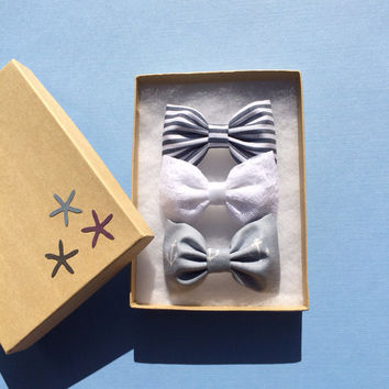 Striped, white lace, and grey anchor hair bows from Seaside Sparrow. Seaside Sparrow hair bows make the perfect gift for her.