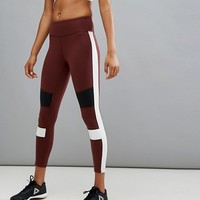 Reebok Training Colourblock Lux Tight In Burgundy at asos.com
