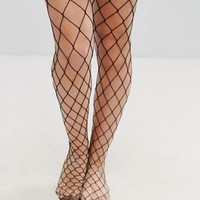 ASOS DESIGN oversized fishnet tights at asos.com