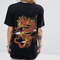 Criminal Damage Oversized T-Shirt With Dragon Back Graphic at asos.com