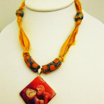Indian Folk art - Mother and Child- Clay Tile Art Pendant on Mustard yellow Sari silk ribbon with Sand Cast beads