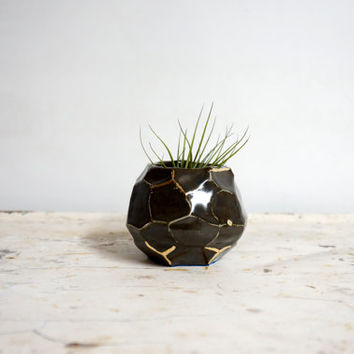 faceted espresso and gold ceramic vessel