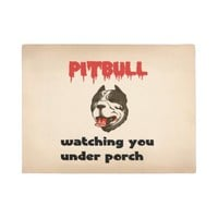 Pitbull watching you,,,under porch doormat