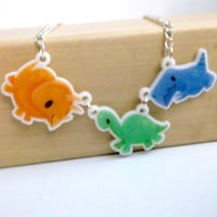 Baby Dinosaurs -- acrylic charm necklace by The Gorgonist