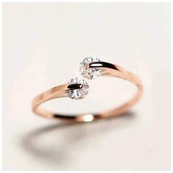 Match Made In Heaven Two Diamonds have come together on a ROSE GOLD on Sterling Silver Ring