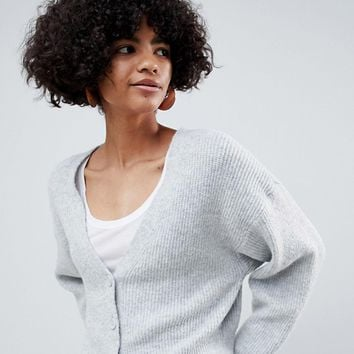 ASOS DESIGN eco cropped cardigan in fluffy yarn with buttons at asos.com
